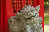 picture of guardian  - Chinese Guardian Lion in Front of Red Structure