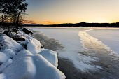 Frozen Lake At Sunset.