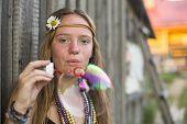 Hippie beautiful girl blows bubbles.