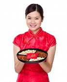 Chinese woman hold with snack tray for lunar new year