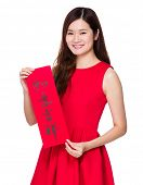 Asian woman hold with china Fai Chun, phrase meaning is everything goes smooth and good luck