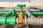 image of groundwater  - Valve mounted on roof top industry building  - JPG