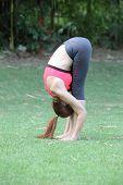 Healthy Woman Doing Standing Forward Fold Uttanasana Hamstring Stretch Yoga On Lawn