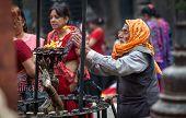 Man Praying In Nepal Temple