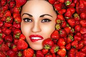 seductive face of woman in strawberries