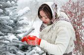 Young Russian woman in winter park