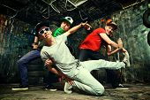 Modern dancers dancing in the garage. Urban lifestyle. Hip-hop generation.