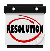 Resolution word on a calendar page to illustrate a new year's vow or promise to ahcieve a goal or complete a task or mission and improve your life, job or career