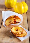 stock photo of crisps  - Quince crisps on wooden table  selective focus - JPG