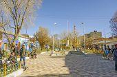 UYUNI, BOLIVIA, MAY 15, 2014: Tourists gather at Plaza Arce, the main square in town