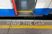 Mind The Gap Sign With Open Train Door