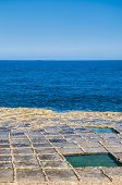 image of gozo  - Salt evaporation ponds also called salterns or salt pans located near Qbajjar on the maltese Island of Gozo - JPG