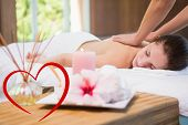 pic of day care center  - Attractive woman receiving back massage at spa center against heart - JPG