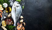 foto of spice  - Delicious fresh fish on dark vintage background - JPG