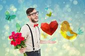 Geeky hipster offering bunch of roses against girly bird and butterfly design