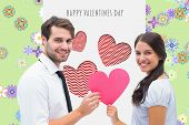 Pretty brunette giving boyfriend her heart against digitally generated girly floral design