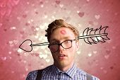 Geeky hipster covered in kisses against valentines heart design