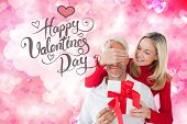 foto of girly  - Loving couple with gift against digitally generated girly heart design - JPG