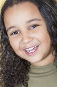 A beautiful mixed race African American little girl female child looking happy and laughing