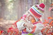 Portrait Of Cute Toddler Girl In The Woods