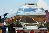 picture of cistern  - The road is reflecting in the fuel tanker of a truck - JPG