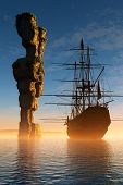 Sailboat and rock in the sea.
