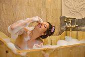 young pretty woman taking a bubble bath