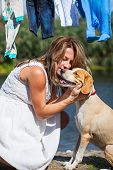 picture of caress  - A pregnant woman is caressing her dog - JPG