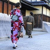 Geisha Walking With Man