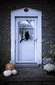 stock photo of casper  - Home front door decorated for halloween season - JPG