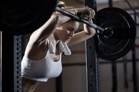 pic of levers  - View of tired girl after weight lifting - JPG
