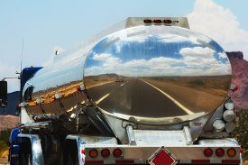 picture of fuel tanker  - The road is reflecting in the fuel tanker of a truck - JPG