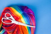 pic of wig  - scissors with color wig on a blue background - JPG