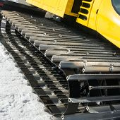 picture of grooming  - yellow tracked vehicle on snow grooming machine - JPG