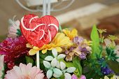 pic of valentine candy  - Candy valentines hearts on background of flowers - JPG