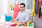 stock photo of thread-making  - Young man fashion designer in atelier - JPG