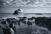 foto of shipwreck  - Old shipwreck long exposure on the rocks at sunset artistic conversion - JPG