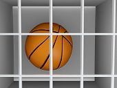 stock photo of lockups  - Basketball in prison conceptual of a sports crime such as match fixing or game dropping during a championship or competition - JPG