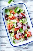 picture of kalamata olives  - Colorful summer salad with kalamata olives in a ceramic dish - JPG