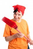 stock photo of ordinary woman  - Middle aged woman smiling with dotted broom isolated on white - JPG