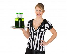 foto of referee  - Portrait Of Beautiful Female Referee With Drinks On Tray Over White Background - JPG