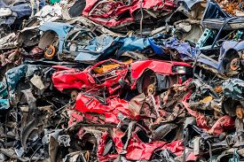 picture of scrap-iron  - old cars were scrapped in a trash compactor - JPG