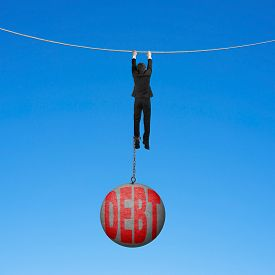 picture of shackles  - Businessman shackled by debt concrete ball hanging on the rope with blue background - JPG