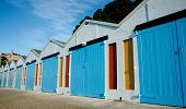 Boats sheds, row of colorful storage sheds.