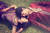 Постер, плакат: Indian couple in traditional wear happy young indian couple in Indian traditional costumes