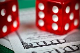 foto of two dollar bill  - two red casino dices on dollars bill - JPG