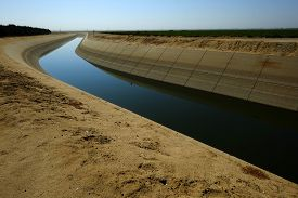 stock photo of water shortage  - The water level is very low in a main irrigation canal in Central California - JPG