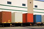 picture of oversize load  - Colorful trailers by the warehouse - JPG