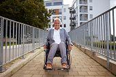 Elderly Wheelchair User On Ramp