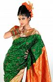 Woman standing in rich green silk-sari